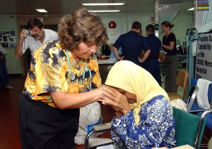 800px-US_Navy_050314-N-6665R-023_An_elderly_Indonesian_patient_shows_her_sincere_appreciation_to_a